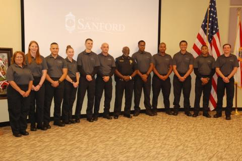 New and future police officers for the Sanford Police Department were introduced by Sanford Police Chief Cecil Smith, center, Monday night at the Sanford City Commission meeting. Smith said the group includes six officers who would be sworn in during a separate ceremony Tuesday, three cadets who will enter the police academy and a 16-week in house training, and two new community service officers. The three cadets should be on the streets by March 2022. Smith told the Herald that before this new group of rec
