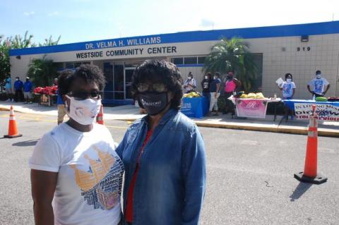 Patrice Anderson (left) and Dr. Velma Williams during the backpack giveaway this Saturday.