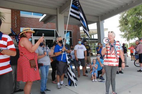 Former Mayor Linda Kuhn (right), who organized the Back the Blue event, speaks to the crowd on Saturday. Kuhn previously worked in law enforcement.