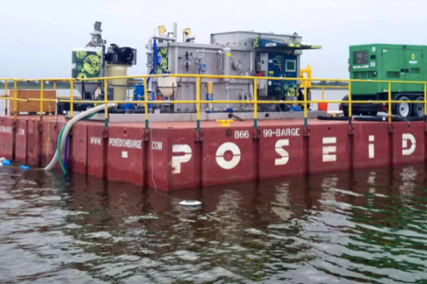 A harvesting unit mounted on a barge will be transported around Lake Jesup so that toxic blue-green algae can be harvested.