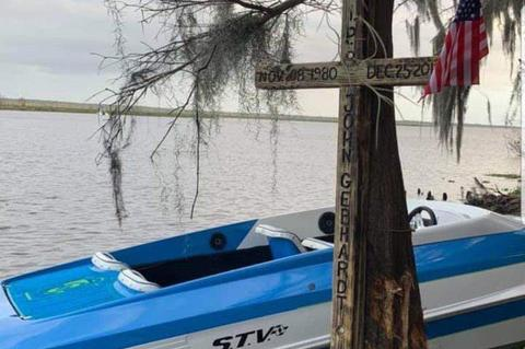 A memorial in the form of a cross was placed on the tree that John E. Gebhardt hit Christmas day with his speed boat. He died on scene from the injuries.