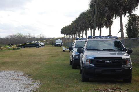 Florida Fish and Wildlife Conservation Commission vehicles line up along the Lake Jesup boat ramp in Sanford during the search for a missing boater last week.