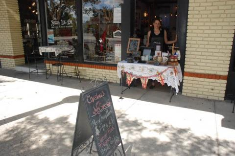Rosie Lee Tea Co. Owner Kim Isaac outside of her store on Park Avenue during the Christmas in July event.