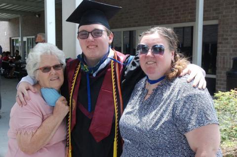 Graduate Corey Creech (center) and his family at the graduation.