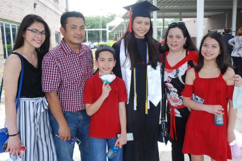 The Crisostomo family with graduate Qrizten. Two of Qrizten's sibilings also attend Crooms Academy of Information Technology.