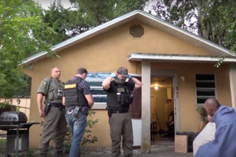 Sheriff's deputies during one of the resulting raids from a six-month investigation.