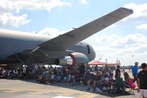 Shade was at a premium during the two performances of the Orlando Air and Space Show over the weekend at Orlando Sanford International Airport. But this wing under a military refueling jet on the tarmac at the show provide a bit of respite from the sun.