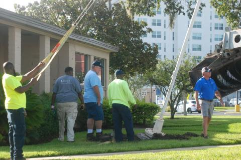 Crews remove the canon, which also contains a flag pole, from out front of the former Greater Regional Chamber of Cemmerce in downtown Sanford. The canon was moved to the Sanford Museum.