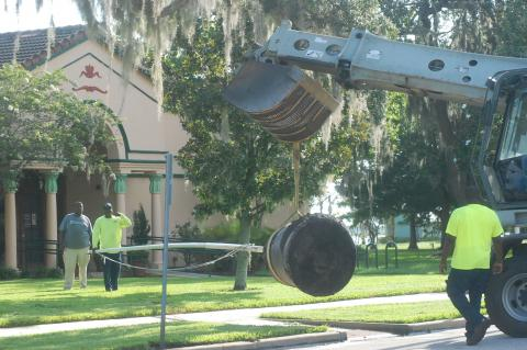 City of Sanford crews move the old canon down the street from the old Sanford of Commerce to the Sanford Museum.
