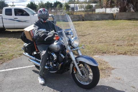 Marshall Dillon of Sanford with his box of food strapped to his motorcycle.
