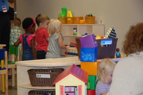 Pre-school children play in one of the new early learning centers at the Florida Department of Health on Airport Road.