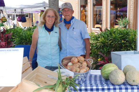 Paula and George Martin of Oviedo's White Rose Farms, selling at the Farmer's Market in Magnolia Square in Sanford on Saturday.