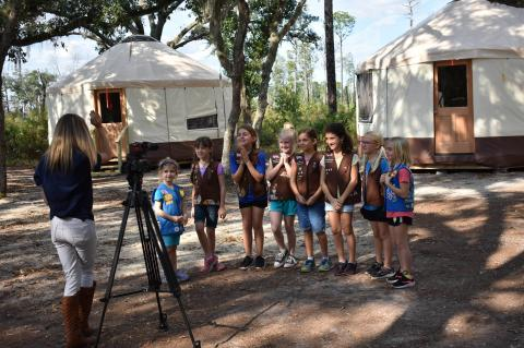 A local Girl Scout troop gathers in front of the tents at the renovated Mah-Kah-Wee camp.
