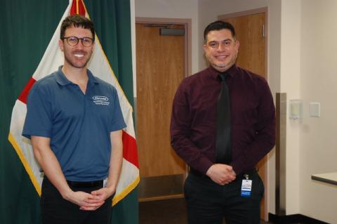 Adam Ledo (left) and Andres Velandia (right) work as a team to interpret Seminole County's press conferences for the Deaf. Velandia, who is Deaf, translates the conferences into a more gestural language, so it can be broadly understood.