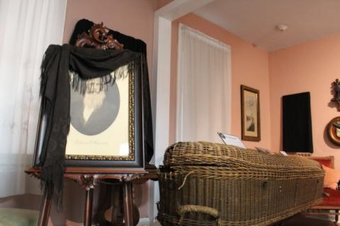 The Museum of Seminole County History exhibit called 'Dearly Departed' focuses how people dealt with death in the Victorian era, uncluding a room set up to look like a wake (above) from that time period.