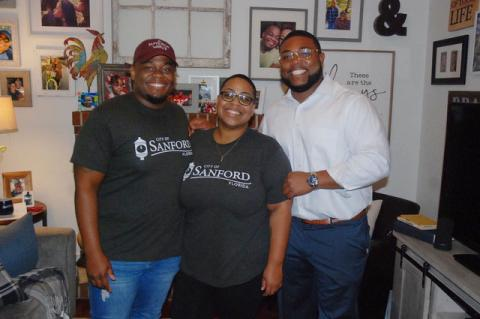 Sheena Britton (center) with her fiancé Morris Robinson (left) and Mario Hicks (right). Britton was expected to be sworn-in on Tuesday.