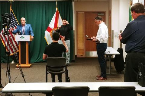 Adam Ledo and Andres Velandia (center) at a recent Seminole County press conference.