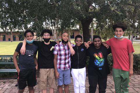"""The Young Men of Distinction club at Milwee Middle School in Longwood will host its first fundraiser called """"Socktober."""""""