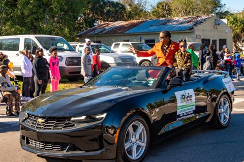 Pastor Paul P. Wright, Grand Marshal, (accompanied by Little Miss Zoë Campbell).