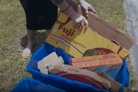 A screen shot from the city's video showing how residents can properly discard of their recycling.