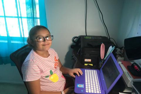 Seminole County Public School student Chelsea Moreno works on her laptop, as her parents have made decision to keep her home during what would have been her first year in middle school.