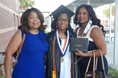 Seminole High 2020 graduate Alice Abia-Okon with mom, Lucy, left, and older sister, Katherine, right.