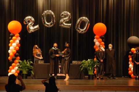 Adminstrators of the graduation ceremony, as well as graduates, all wear masks while participating in their graduation ceremony on Friday. Ceremonies were held throughout the day in small groups.