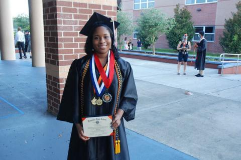 Alice Abia-Okon proudly shows off her diploma. She plans to attend the University of Florida.