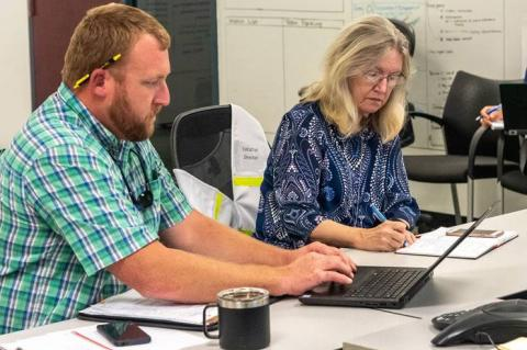 Dave Dickens, director of transportation, facilities and safety services, and District Executive Director Dr. Ann Shortelle guide the District's preparation for and response to severe storm events and other emergencies.