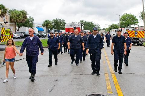 Members of the Seminole County Fire Department (above) are welcomed home after being deplyed to Miami to help with the search and rescue efforts at the collapsed Surfside building.
