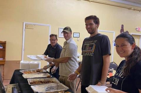 Members of the Orlando Baptist Church host a weekly food giveaway, feeding 50 homeless people.