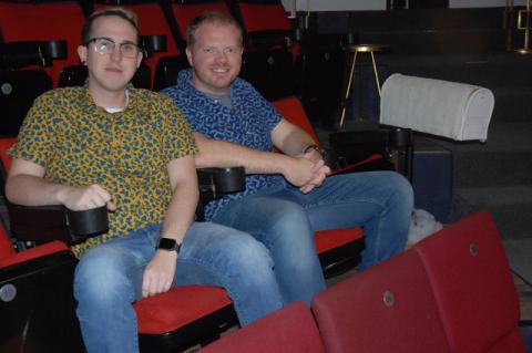 Derek Critzer and Quinn Roberts sit in two of the 152 seats of the Theater West End, which is planning on becoming a non-profit and needs help from the community to continue in its current 1st Street location.