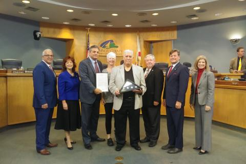 Former Staff Sgt. William E. Waterman Jr. (center) was recognized at a recent Seminole County Commission meeting.