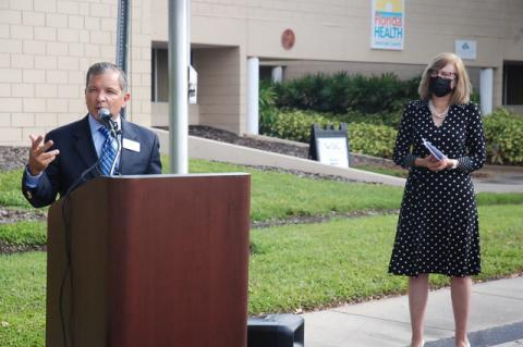 Lui Damiani, executive director of the Victim Service Center of Orlando, speaks to reporters and advocates Wednesday at the Florida Department of Health—Seminole County as Seminole Health Director Donna Walsh looks on.
