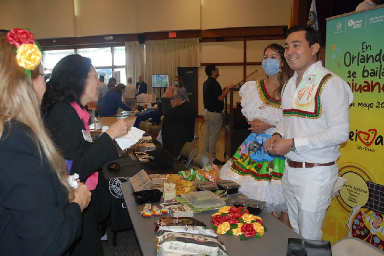 Edison Rodriguez and Tatiana Muñoz, on right, wear native homemade clothing and represent the City of Neiva at the Florida Business Convention. Tatiana is the daughter of Neiva's Mayor Gorky Muñoz.