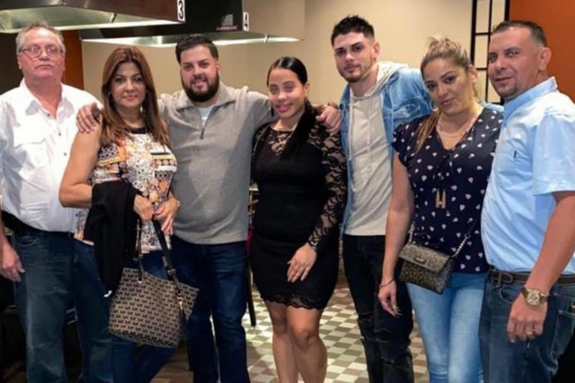 David Roman, 64, and his wife, Minerva Barreto, 57, (left) with their family. Roman and Barreto were killed in a hit-and-run crash July 11.